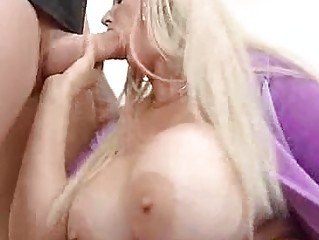 Busty blonde in violet shirt does blowjob stiff boner