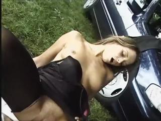 Brunette bitch Denise La Bouche gets fucked next to the car on the side of the road