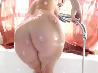 Babe Sophie Dee showers off after a hard work out