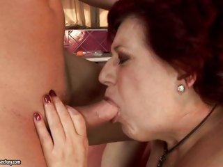 Hetty puts a young cock over her knees and spanks it like a grandma should