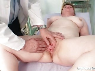 Ugly mom gets a swab stick up her hairy pussy