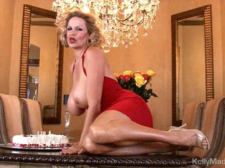 Kelly Madison has fun with her birthday cake on tits