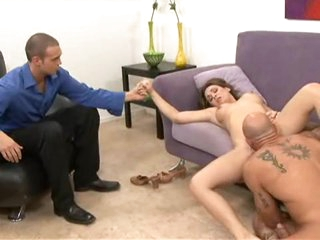 Holly West munches on a monster cock while her husband watches.