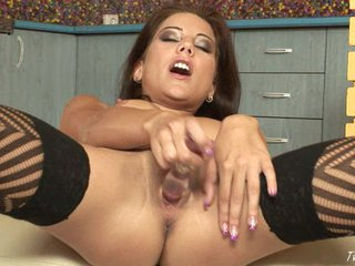 Anita Pearl inserts a nice, long wine glass into her tiny pussy