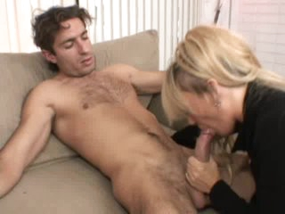 Milf gets on her knees to give blowjob
