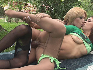 Well-endowed ladyboy and a sexy sweetheart going to picnic for a hardcore session