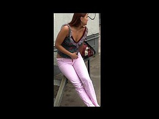 Taut pee-soppy pink jeans in the stree