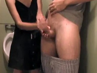 Enjoy my GF while she does what she knows best - she jerks me off while her friend is taping us in the public toilet for our home made sex collection.