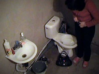 Salacious brunette gadget used her time in the toilet to look in the pocket-glass. She pissed while checking her make-up and then put on her beige panty and jeans and got out of the room having no idea she was filmed!