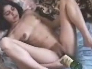 Close up of big young pussy, which get spread by her extremely excited owner and filled with wine bottle.