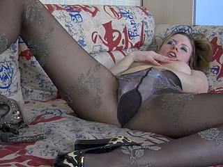 Smoking seductress teasing with her lengthy legs encased in luxury hose