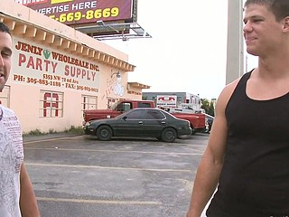 Sexy brunette guy is not against to take in his innocent mouth a huge dick for the money.