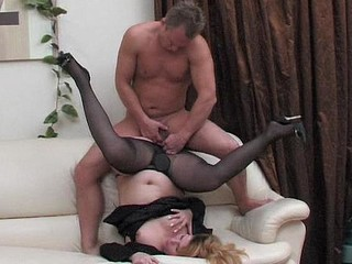 Older business woman in full-fashioned hose taking dick up her beaver