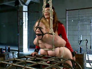 Darling is hot, she has big natural boobs that have been tied real hard and the mistress putted clamps on her nipples after spanking her booty. She is bend on that cage and receives the harsh treatment only her mistress knows how to apply. Look at her body tied up and at her sexy mouth ball gagged, wonder what will happen next?