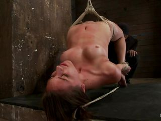 She's hanging on a rope and while her shaved cunt is being vibrated the guy that is punishing her makes things a lot more hotter for her as he inserts his hard penis between her nice lips. The chick bends and obeys as her master does everything he desires with her body, after all that sucking will he have mercy for her and cum on that pretty face?