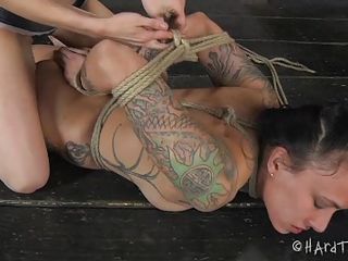 Henna is a lesbian worthless whore. She loves cunt and being tied up only makes her horny. Her mistress knows what a bitch she is and she spreads her superb thighs in front of Henna after she tied her up. Watch her, how lustful she licks and sucks that bald cunt, damn this brunette likes juicy cunts!