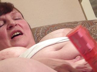 Anita C is a fatty granny. She has got huge boobs and she is about to have her desired masturbation. She is taking her clothes off and then she is crushing her boobs to make her fell horny. Then she is rubbing pussy and inserting a huge dildo in her wet pussy to take the feeling of having a huge dick in her pussy.