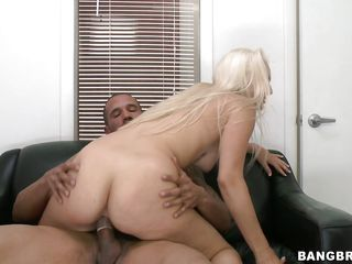 Luscious blonde milf Maci is ridding a hard dick with all her powers. She doesn't wants to miss a single inch of the guy's penis and takes it as deep as she can in cowgirl position then from behind. As the guy drills her big white booty she smiles with pleasure and after a bit more ridding this blondie kneels and rubs the penis so she can enjoy a big load of semen. After all that hard working he receives her prize and a thick load of cum covers her face, some ending on her eyelid.