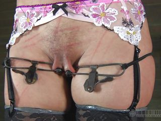 Hot milf Cherie is all tied up like Jesus Christ and is proud of her life experience as a whore. She has dents of whipping all over her tight abs and her pussy lips are tortured as hell. Her girlfriend is taken into a box from which she can not move at all and for sure she can not escape. Check it out!