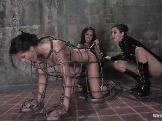 Jennifer Dark is a hot milf with brown hair who enjoys being punished while she is tied up with ropes. Watch busty dominatrix I5is Love and her friend punishing her as she's on her hands and knees, bound inside of an iron human shaped cage. Then the strapon comes out and she gets plowed deeply.