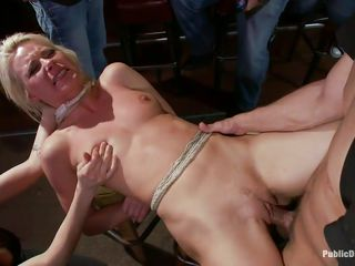 Anikka is hot and blonde, she has a pair of sexy titties, a nice booty and a mouth that begs for cock and semen. Watch her all tied up and getting fucked hard by the boys in that pub. She's being disgraced and loves it, this pretty slut deserves a good old deep fuck and screams both with pleasure and pain as they fuck her