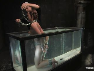 Here is Sara, she was a bad dirty girl and now it's time for some water bondage and punishment. He tied her thin fragile body in chains and wrapped a chain around her neck too so the weight will keep her at the bottom. She likes what he's doing and for that she receives a hard slapping on her ass.