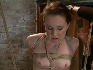 AnnaBelle Lee is all tied up in the dungeon, straddling what looks like a type of sawhors e. Her mistress puts a nylon stocking over her head and then attaches two suckers to her nipples. After a brief moment of pleasure from a vibrator, the mistress gets a whip and starts lashing her legs.