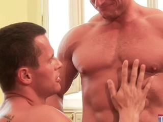 Two strong fellows fucking each other bareback