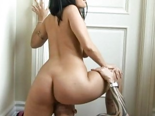 Hot ass brunette with large honkers rides tattooed guy's cock