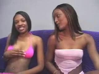 Young black girl sits and sucks his dick